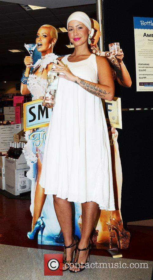 Amber Rose promotes and signs bottles of Smirnoff...