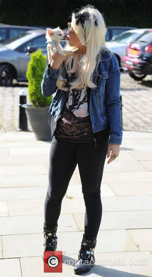 Arrives at Key 103 radio station with her...
