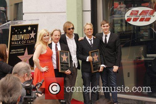 Gerry Beckley, Dewey Bunnell and their children...