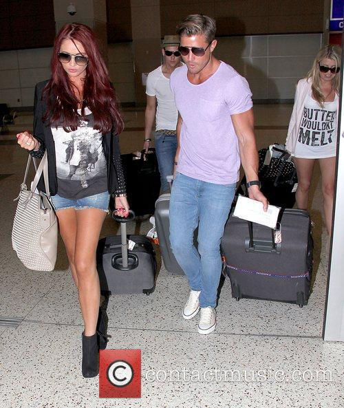 Amy Childs in denim hot pants arrives at...