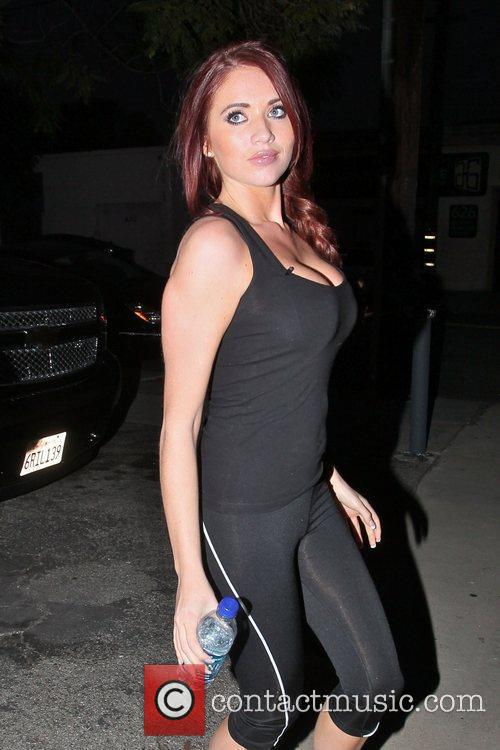 Amy Childs dressed in black Lycra clothing goes...
