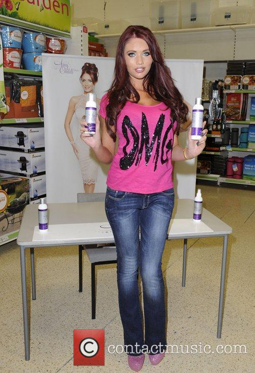 Amy Childs promotes her new range of tanning...
