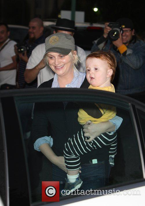 Amy Poehler and her son Abel Arnett seen...