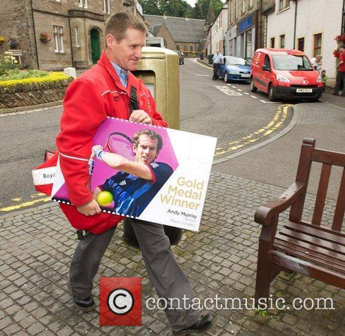 Dunblane postman John Elliot with a commemerative Andy...