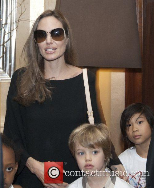 Leaves the Hotel Europe with her children Knox...