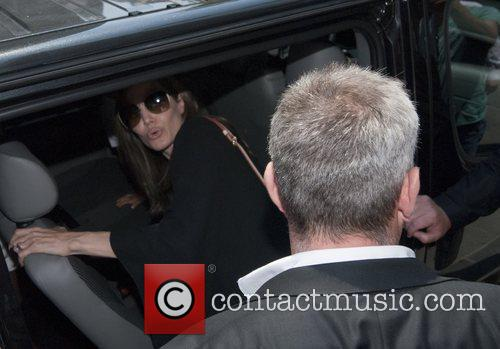 angelina jolie leaves the hotel europe with 3983268