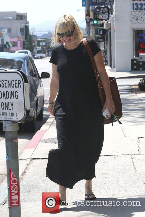 A very pregnant Anna Faris is seen leaving...