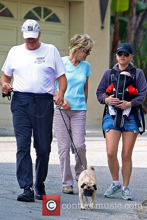 Seen with her son Jack and her parents,...