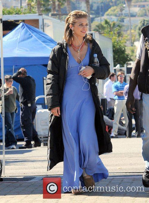 AnnaLynne McCord in a blue dress filming on...