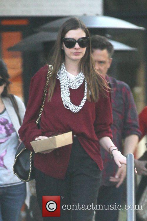 anne hathaway departs a restaurant with carry 5782408