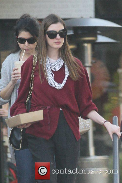 anne hathaway departs a restaurant with carry 5782410