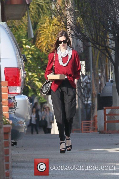 anne hathaway departs a restaurant with carry 5782413