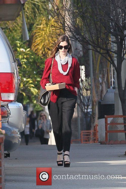 anne hathaway departs a restaurant with carry 5782414