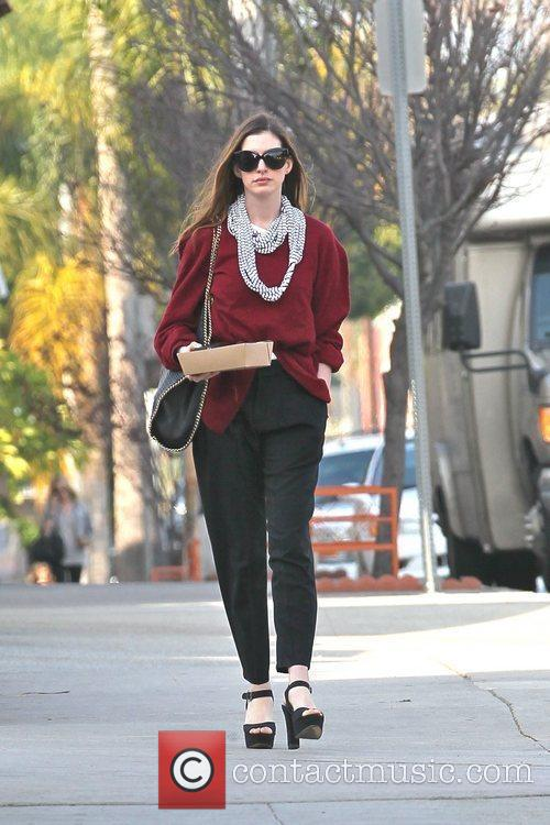 anne hathaway departs a restaurant with carry 5782417