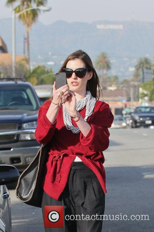 anne hathaway departs a restaurant with carry 5782428