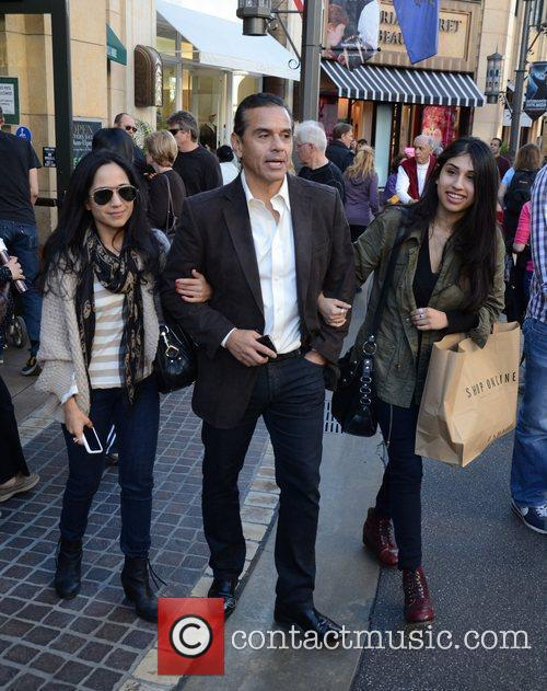 Shops with his daughters at The Grove