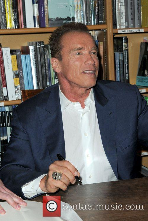 Promotes and signs copies his new book 'Total...