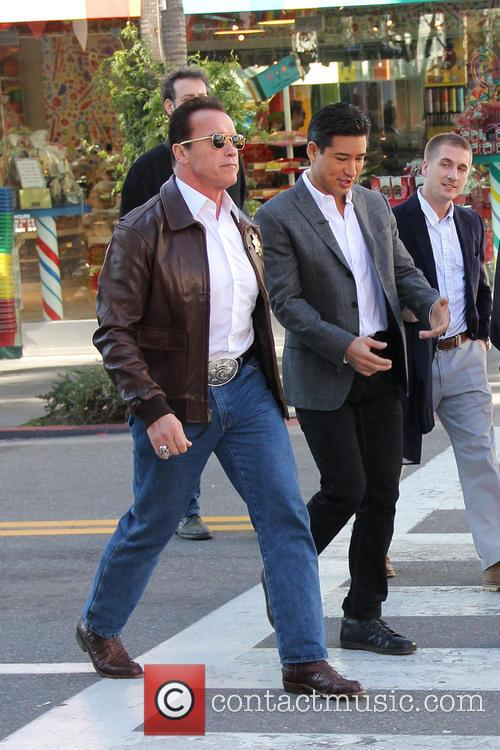 Arnold Schwarzenegger; Mario Lopez Arnold Schwarzenegger drives a...