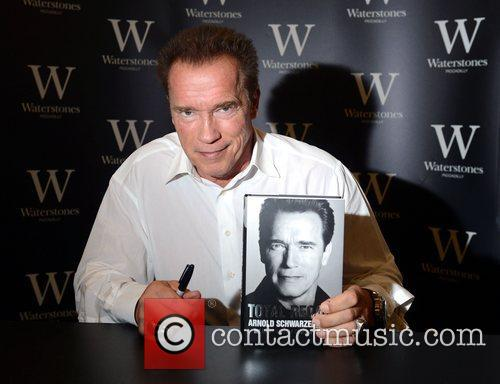 Arnold Schwarzenegger signs copies of his new autobiography...