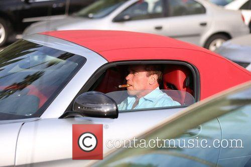 Arnold Schwarzenegger returns to his Bentley with a...