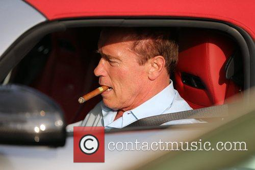 Returns to his Bentley with a cigar in...