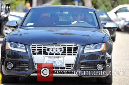 Patrick Schwarzenegger drives himself to a restaurant in...