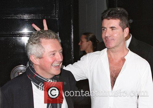Simon Cowell looking worse for wear, leaving the...