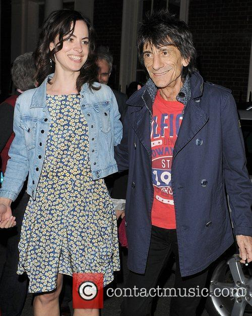 Ronnie Wood and a female companion leaving The...