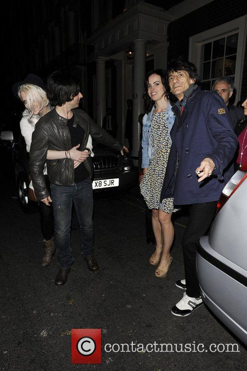 Ronnie Wood, Kelly Jones and a friend leaving...