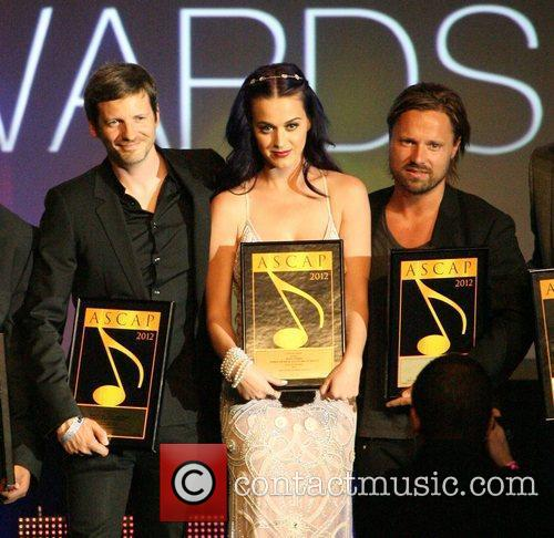 [L-R] Dr. Luke pictured with Katy Perry and Max Martin at the 2012 ASCAP Awards