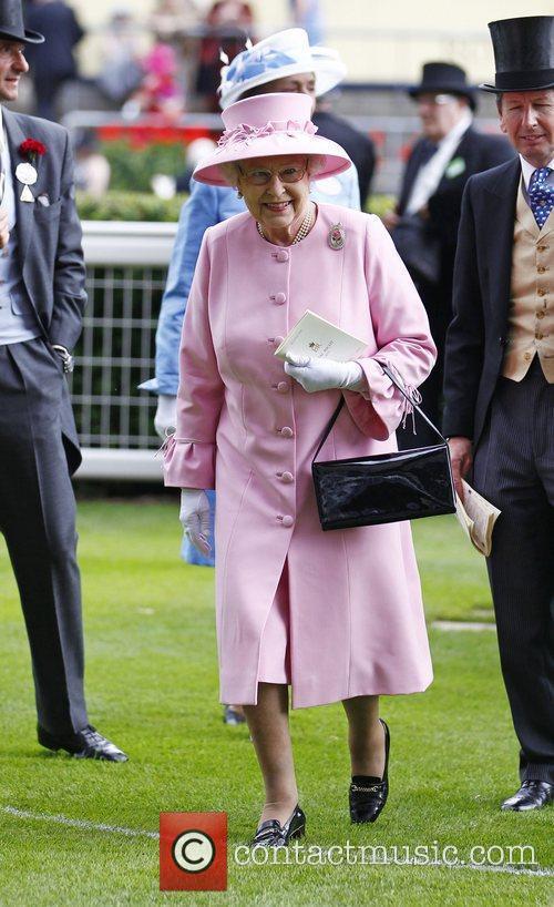 Queen Elizabeth in the paddock before her horse...