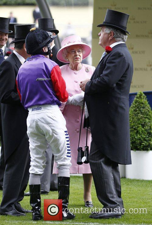 Queen Elizabeth talks to trainer Michael Stoute and...