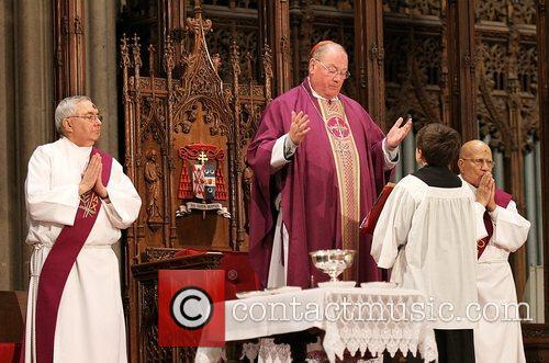 Newly elected Cardinal Timothy Dolan leads an Ash...