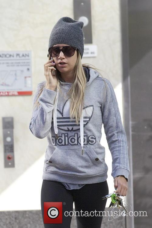 Ashley Tisdale makes her way to the gym