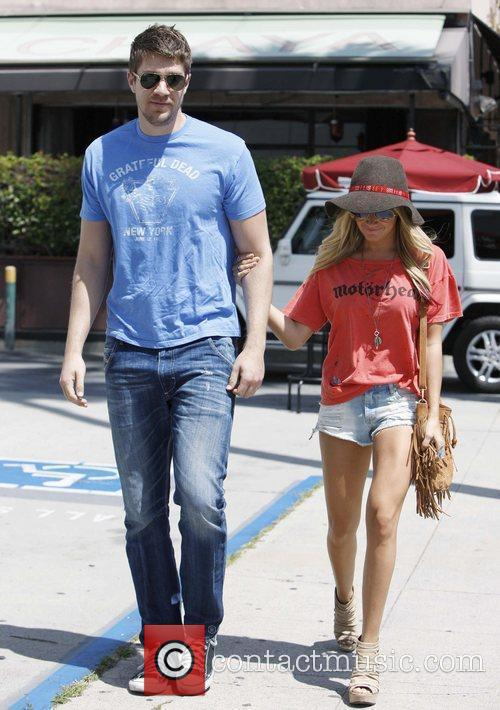 Ashley Tisdale and her boyfriend Martin Johnson are...