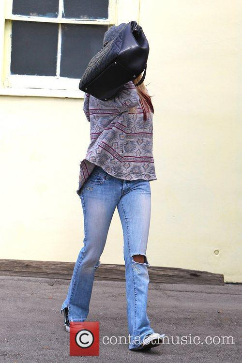 Ashley Tisdale avoids the paparazzi while out in...