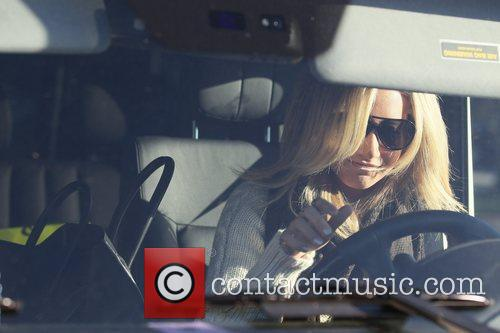 Ashley Tisdale exits Byron Tracey in high spirits...