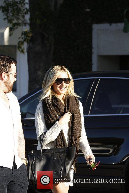 Leaving Byron and Tracey Salon after getting her...