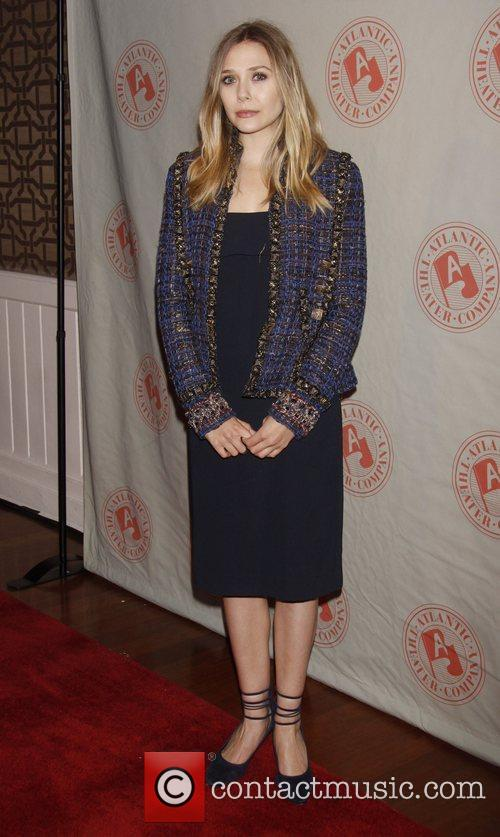 Elizabeth Olsen wearing a Chanel jacket and a...