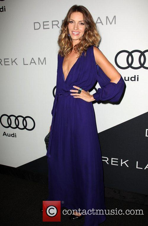 Dawn Olivieri Audi and Derek Lam celebrate the...