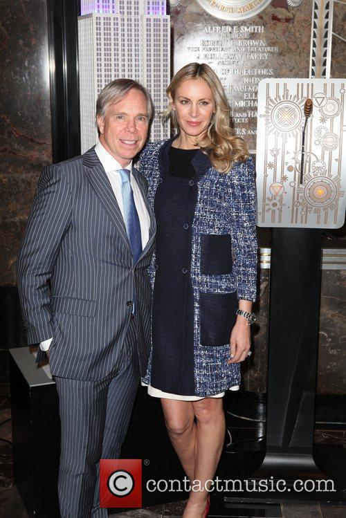 Tommy Hilfiger, Suzanne Wright and Bob Wright light...