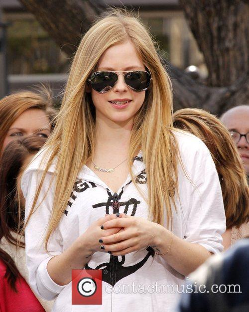 Avril Lavigne appears on the entertainment news show...