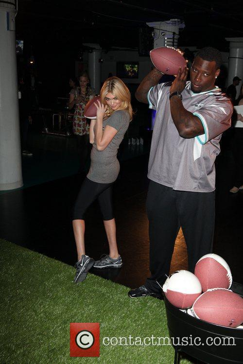 Giants defensive end Jason Pierre-Paul and model Kate...