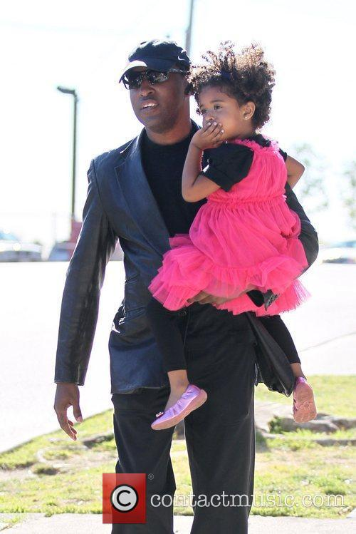 Singer Babyface and his daughter are seen out...
