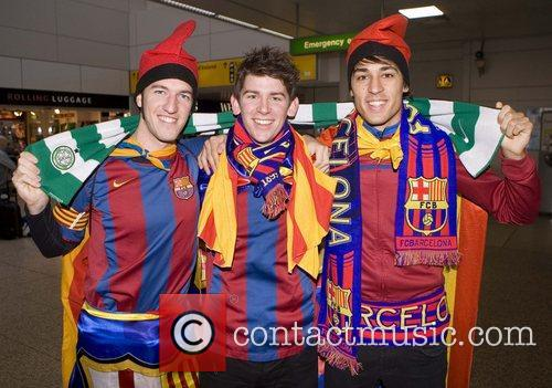 FC Barcelona fans await the team at Glasgow...