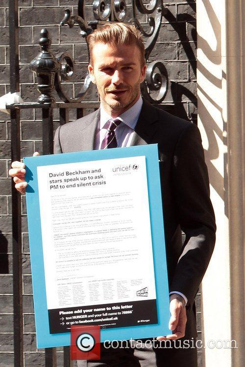 Outside Number 10 Downing street to hand in...