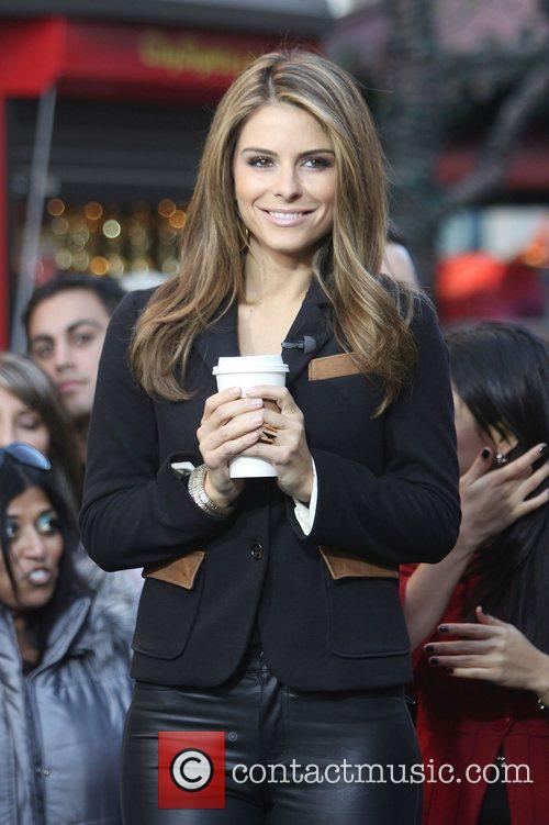 Maria Menounos films an appearance for entertainment news...