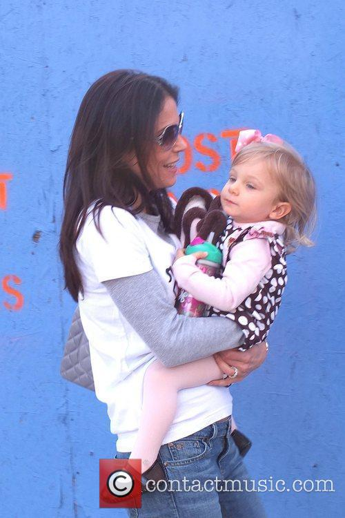 Bethenny Frankel and her daughter Bryn Hoppy strolling...