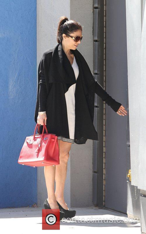 Bethenny Frankel out and about carrying a red...