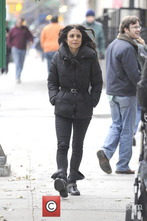 Bethanny Frankel, wearing a black puffer coat is...